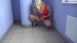 Blonde pissing in entrance